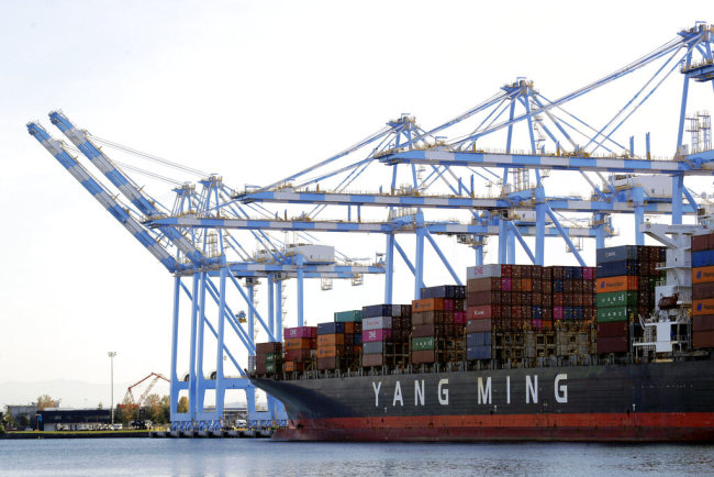 Cargo cranes are used to take containers off of a Yang Ming Marine Transport Corporation boat at the Port of Tacoma in Tacoma, Washington, Nov. 4, 2019. [File Photo: AP/Ted S. Warren]